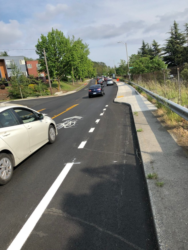 A bike lane ends in a curb forcing a merge into heavy car traffic
